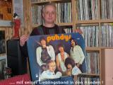Bernd mit Poster.JPG