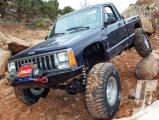 154_1203_10+jump_the_gun+jeep_comanche_drivers_side_front_three_quarter.jpg