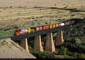 4150_1351279313A  across the large bridge at the west end of Abo Canyon in New Mexico on September 17, 1992. Led by Superfleet FP45 No. 96 and GP30 No. 2759,.jpg