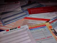 Kundenkartenanträge, Coupons, Karten händisch ausgefüllt